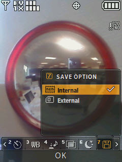 Camera screen with focus on the save option menu options