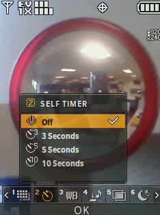 Camera screen with focus on the self timer menu options