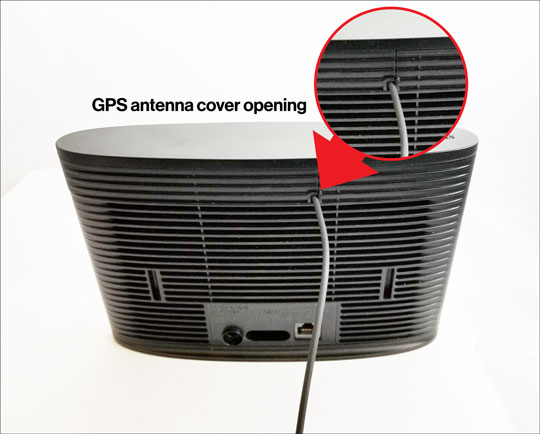 GPS antenna opening with cable threaded through